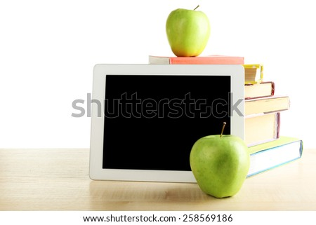 Books, PC tablet and apple on desk, isolated on white - stock photo