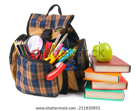 Books, school accessories and a backpack. On a white background.