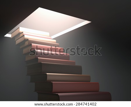 Books stacked ladder shaped on a concept of knowledge and growth. - stock photo