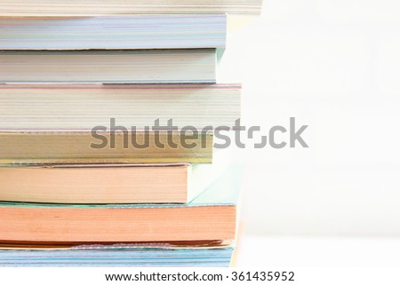 Books stacking. Back to school background. - stock photo