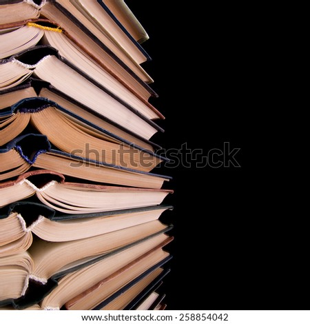Books stacking. Back to school. Black background. - stock photo