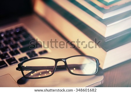 books with eye glasses