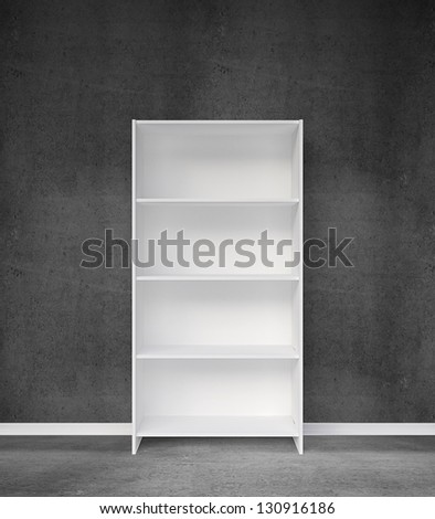 bookshelf and gray concrete wall - stock photo