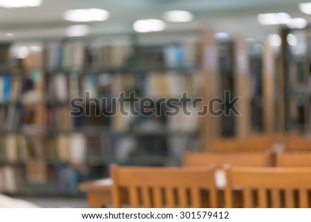 bookshelf and table desk in library, education abstract blur defocused background - stock photo