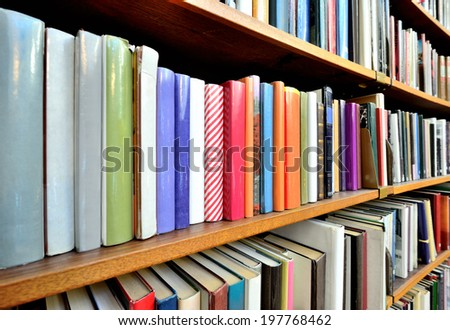 Bookshelf in public library - stock photo