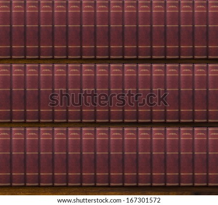 Bookshelf with old hardcovered books background - stock photo