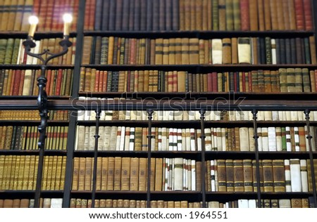bookshelves at the library, full of old books - stock photo