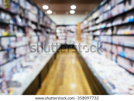 Bookstore Shelf Blurred Shop Background in perspective - stock photo