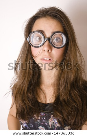 bookworm, cute young woman in glasses - stock photo