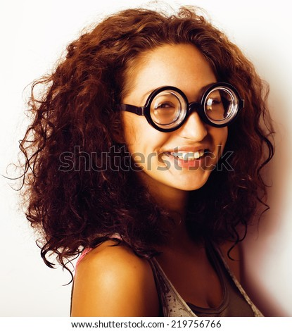 bookworm, cute young woman in glasses, curly hair - stock photo