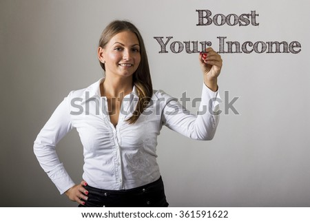 Boost Your Income - Beautiful girl writing on transparent surface - horizontal image
