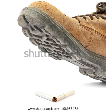 Boot steps on a broken cigarette isolated on the white background - stock photo