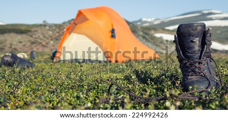 boots ant Tent - stock photo