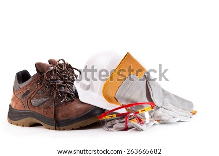 Boots, hardhat, goggles and gloves on a white background - stock photo