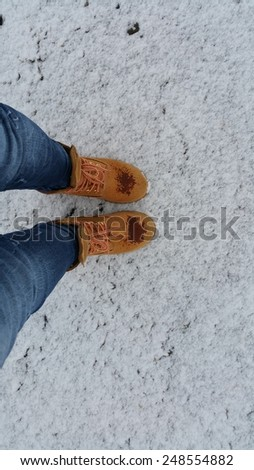 Boots in snow background - stock photo