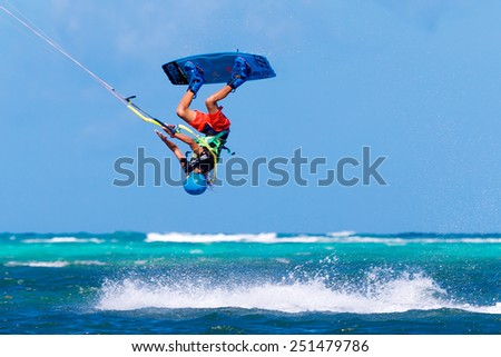 """Boracay island, Philippines - January 28, 2015 : unidentified kite-surfer performs in competitions """"The Boracay internanional funboard cup 28-31 January, 2015"""" Freestyle category.  - stock photo"""