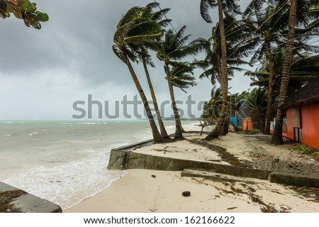 BORACAY, PHILIPPINES - NOVEMBER 8 2013: Super Typhoon Haiyan batters the eastern facing shores of the central Philippines.  Haiyan is one of the biggest storms ever recorded to hit land. - stock photo