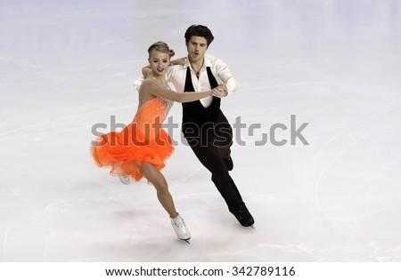 BORDEAUX, FRANCE - NOVEMBER 13, 2015: Alexandra STEPANOVA / Ivan BUKIN of Russia perform short dance at Trophee Bompard ISU Grand Prix at Patinoire Meriadeck Arena. - stock photo