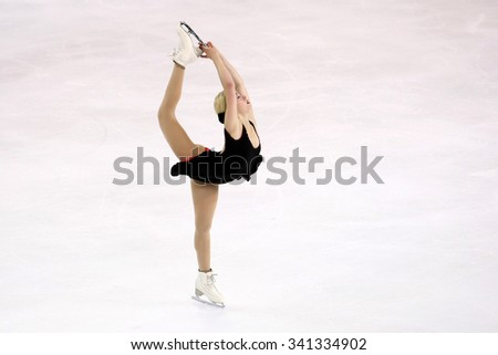 BORDEAUX, FRANCE - NOVEMBER 13, 2015: Gracie GOLD of USA performs short program at Trophee Bompard ISU Grand Prix at Patinoire Meriadeck Arena. - stock photo