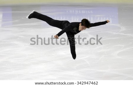 BORDEAUX, FRANCE - NOVEMBER 13, 2015: Jin Seo KIM of Korea performs short program during the official training at Trophee Bompard ISU Grand Prix at Patinoire Meriadeck Arena. - stock photo