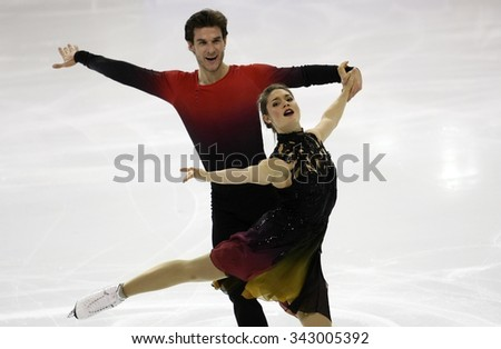 BORDEAUX, FRANCE - NOVEMBER 13, 2015: Laurence FOURNIER BEAUDRY / Nikolaj SORENSEN of Denmark perform short dance during the official training at Trophee Bompard ISU Grand Prix at Meriadeck Arena.