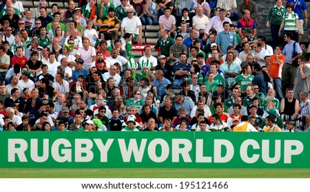 BORDEAUX, FRANCE-SEPTEMBER 09, 2007: rugby fans watching the match Ireland vs Namibia, of the Rugby World Cup, France 2007, in Bordeaux. - stock photo