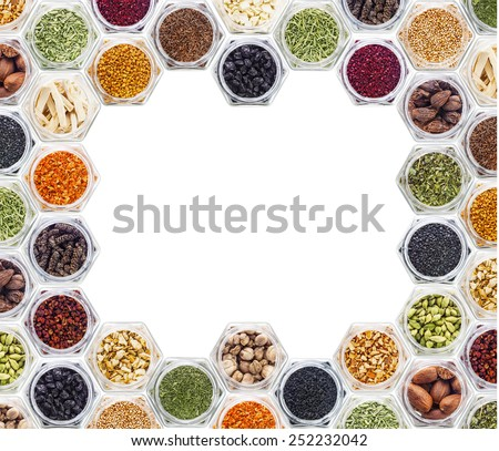 border frame of colorful powder spices with copy space for text isolated on a white background - stock photo