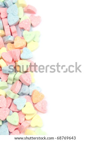 Border made of little colorful candy hearts - stock photo