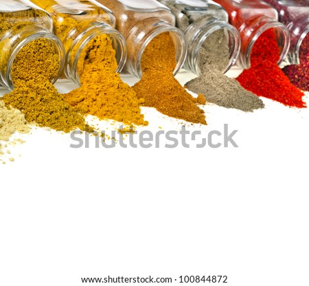 border of aromatic powder spices in glass bottle isolated - stock photo