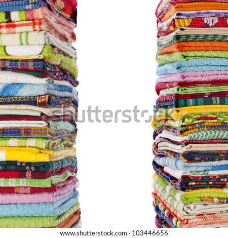 Border of colorful Kitchen towels on white background - stock photo