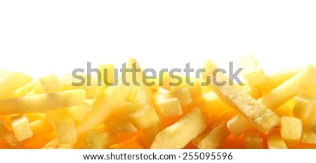 Border showing the close up texture of a pile of French fries or fried potato chips over white with copyspace for a restaurant, tuck shop or cafeteria - stock photo