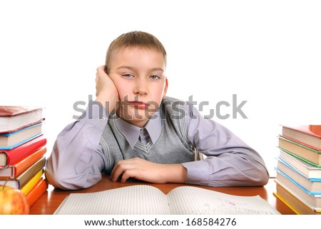 Bored Boy on the School Desk Isolated on the white background - stock photo