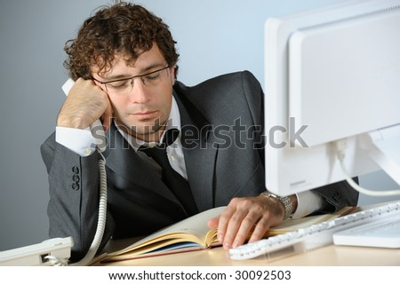 Bored businessman - stock photo