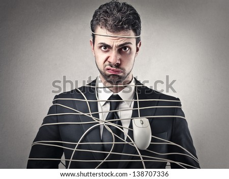 bored businessman tied with wire mouse - stock photo