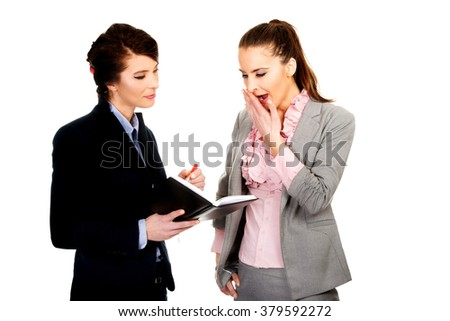 Bored businesswoman talking with her partner. - stock photo