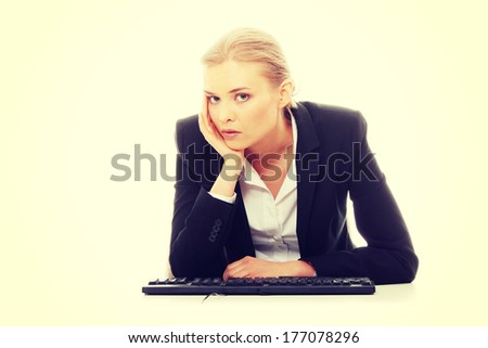 Bored businesswoman working on pc, isolated on white background