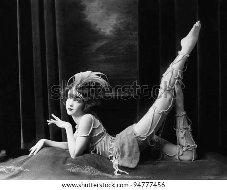 Bored dancer posing in beaded costume - stock photo