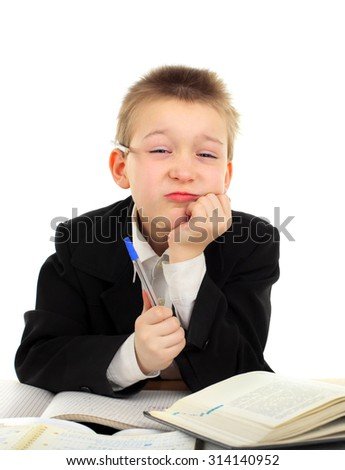 Bored Kid on the School Desk Isolated on the White Background - stock photo