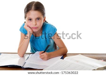 bored little girl studying - stock photo