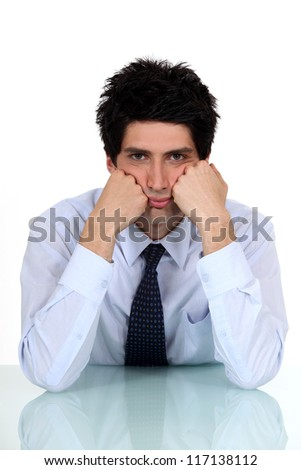 Bored office worker - stock photo