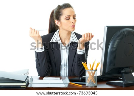 bored office worker works on her nails, holds nailfile in one hand and blow nails on the other one, isolated on white