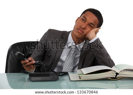 Bored telephone sales worker - stock photo