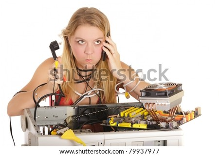 bored woman calling technical support to repair computer - stock photo