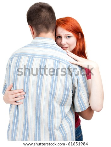 bored woman hugging by man, white background - stock photo