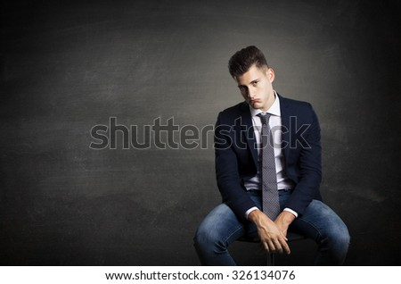 bored worker on little chair - stock photo