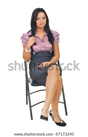 Bored young business  woman sitting on chair isolated on white background