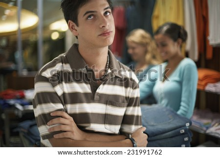 Bored Young Man in Clothing Store - stock photo