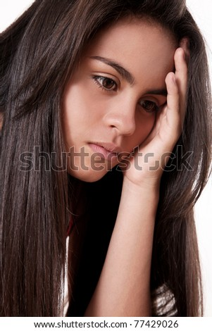 Boredom and depression in the face of a beautiful woman - stock photo