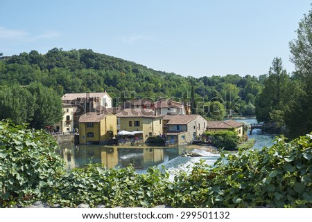 BORGHETTO, ITALY - JULY 11: Village of Borghetto surrounded by vegetation and coasted by river Mincio. July 11, 2015 in Borghetto. - stock photo