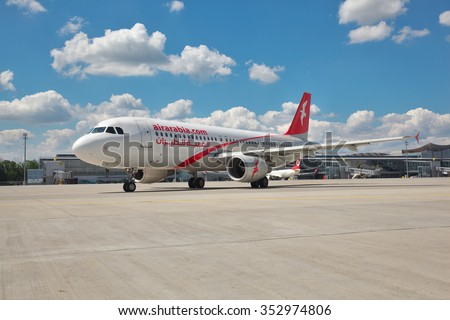 Borispol, Ukraine - July 5, 2014: Air Arabia Airbus A320 taxiing along the apron to the runway - stock photo